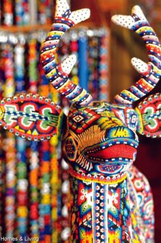 Huichol (Mexico) Art - intricate religious symbols composed of seed beads pressed into beeswax over a carved wood base