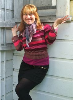 Long skinny crochet scarf tied in a bow
