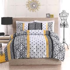 Black and Yellow Dot Stripe   Bedding  (Black, White, and Yellow Polka Dot Damask   Striped Bedding)  Bold black and white dots and damask prints in   a striped patterns with a touch of bright color.   This microfiber comforter will bring a   sophisticated air to your room with a little POP   of yellow.