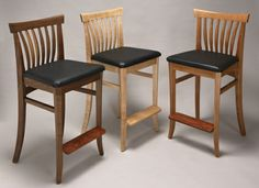 Barstools with upholstered seats by Greg Aanes.
