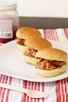 Crockpot pulled BBQ chicken. This recipe seasons the chicken breasts, instead of just leaving them plain to cook in the bbq sauce.