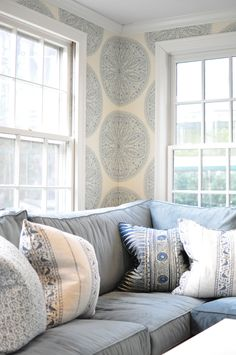 Family room by Deepdale House LLC | Blue and White Upholstered Walls pillow, house design, couch, family room blue, hous llc