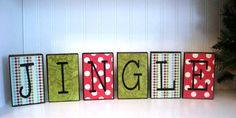 "Decorate with Fun and Retro Christmas wood blocks that say ""Jingle"""