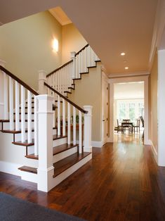 Wooden Stair Railings Design- love this, dark wood step with white bottom