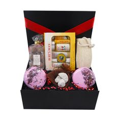 "This delightful ""bath & beauty"" gift box hamper comes filled with lovely items for having a special pamper session,includes wonderful products from the natural Burt's Bees range, bath bombs,loofah and pumice stones, along with the pamper goodies there are some delicious indulgent truffles. Perfect luxury gift on any occasion"