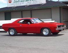 1970 Plymouth Cuda - Red - Side Angle - 1152x864 Wallpaper    Image Copyright Serious Wheels