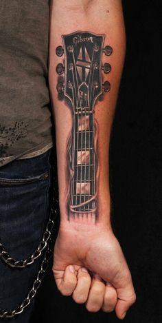 Guitar tattoo - that's pretty cool For more guitar related stuff check out http:/www.edinburghguitarandmusicfestival.co.uk/gmfstore
