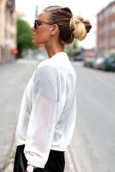 White shirt and bun.