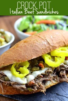 Crock Pot Italian Beef Sandwiches are so delicious and made with just 5 ingredients! #crockpot #slowcooker #beef #recipe #dinner | iowagirleats.com