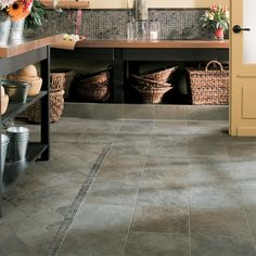 Check out this American Olean product: Photo features Highland Ridge Evergreen in 12 x 12, 6 x 6, and 6 x 12 cove base with Tumbled Slate China Multicolor 1 x 1 and Candalara Glass Cinnamon Spice Torello.  Floor tile looks like slate but has the durability of porcelain!