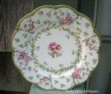 Antique Haviland Limoges Plate    A Rare Variation Of Schleiger #72 On The Star Blank With A Green Border    Haviland Schleiger #72 is a pattern featuring pink rose garlands along with green leaves and other small flowers on the scalloped double gold trimmed Star blank #5. This very special pattern covers most of this plate with an inner border of green leaves and flowers and a green border between the gold trim borders.    This Is An Exquisite Antique Haviland Plate!  $64.00