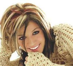dark brown hair with blonde highlights and red streaks to set it off
