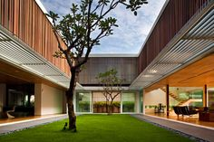 Designed by Wallflower Architecture + Design this truly unique house occupied 855 square meters space on a 1200 square meter site. The house is located in Singapore and has plenty unusual ideas implemented in its design. The best one among these things is an internal garden. Thanks to column-free vistas the garden connects all public spaces like the entrance, dining areas, swimming pool and formal living area. The private spaces in contrary are hidden from visitor's eyes. All the courtyards have