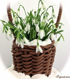 Snowbells basket - There is a cake inside the basket. Snowdrops are sugar.