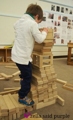 zella said purple: just playing? climbing a block tower