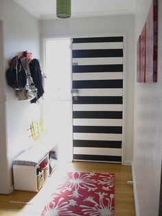 stripes, pink, pattern, green. Black and white striped interior of Lisa Barrett's front door.