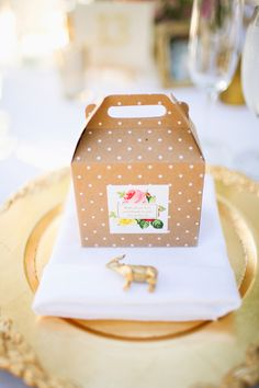polka dot wedding favor box, photo by Adrienne Gunde http://ruffledblog.com/christmas-house-inn-wedding #weddingideas #weddingfavors