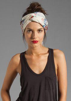 black tank, turban style headband & red lips.