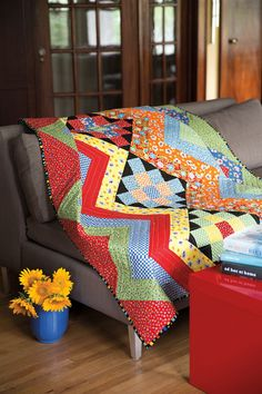 Just a few Album blocks (Granny Squares) and Half Log Cabin blocks make one ziggy granny quilt. This is a color blast of a #quilt! Digital pattern available at shopfonsandporter.com. Look for Ziggy Granny in #Easy Quilts Fall '14.