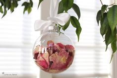 Save the petals from your wedding bouquet in a christmas ornament.  What a cool keepsake idea!