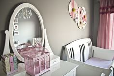 A #gray #nursery looks so chic with #white furniture and #pink everything else!  #birdcage #diycurtains #chandelier