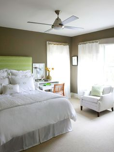 Easy Serenity        Simplicity reigns in this bedroom, where an uncluttered look and a limited gray, white, and lime-green palette make for an oasislike retreat. At night, the stone-gray wall color is cozy and enveloping. During the day, all-white bedding and window treatments keep the room bright. In a room this quiet, it only takes one dose of color to make an impact, and the tall headboard in brilliant lime delivers