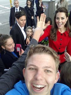 """New Zealand Redditor stasechatus on Tuesday uploaded this photo of Catherine, Duchess of Cambridge, photobombing the selfie of a young man (""""his mate's little brother"""") in the crowd. 
