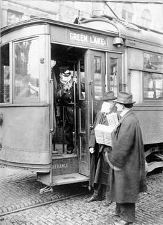 Street car conductor in Seattle not allowing passengers aboard without a mask. (1918)