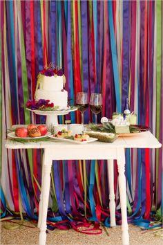 dessert table with colorful backdrop #cake #caketable #weddingchicks http://www.weddingchicks.com/2014/02/21/jewel-wedding-ideas/