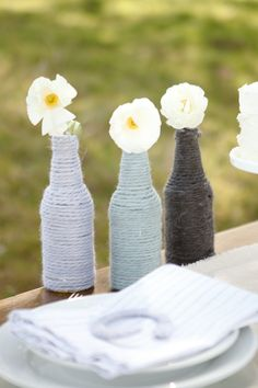 This is soooo #country #wedding cool! #DIY  wrapped twine around beer bottles with simple flowers. . .classic