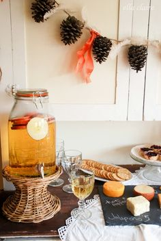 Sparkling Cider Recipe, Fall Party Food Vignette, and Autumn Abounds by Ella Claire: Love the pinecone decorations, this might be nice for an impromptu post-soccer spread one weekend when the family visits