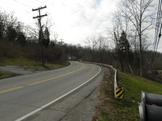 Harrison Avenue's Dead Mans Curve, Ohio:  Harrison Avenue's so-called Dead Mans Curve is said to be haunted by a phantom hitchhiker. Those that see him on this stretch of road become filled with an extreme sense of fear, that they can't explain. No one is known to have ever picked him up, but those that have gotten a good look at him say he is burned, with flesh hanging from his face. He is said to be a man who died in an accident here in 1953.