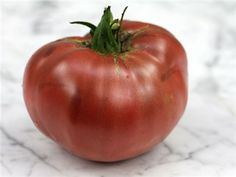 Cherokee Purple - An old Cherokee Indian heirloom, pre-1890 variety; beautiful deep dusky purple-pink color, superb sweet flavor, and very large sized fruit. Try this one for real old-time tomato flavor.