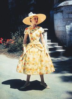 Audrey Hepburn during the filming of Funny Face (1957) in Paris. Dress by Givenchy.