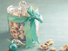 Mix Chex cereal, red & green M, pretzels, peanuts, miniature marshmallows, and pour melted vanilla-flavored candy coating over. Mix well, and spread on wax paper and cool. Break into chunks and give as great Christmas gift!