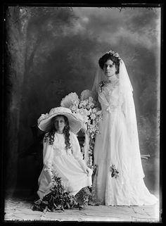 Mrs. Magrath and child attendant, 1913.