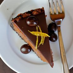 Chocolate Espresso-Orange Cheesecake with Grand Marnier Ganache and Candied Orange Peel
