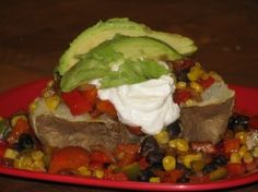 Caliente Baked Potato- 420 calories, 13 g of fiber... filling meal!  Drop the greek yogurt or use faux sour cream