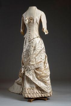 Silk and damask dress, circa 1884. The donor's mother wore this Paris-made dress for her wedding.  Via Charleston Museum, flickr.