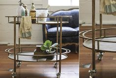I absolutely LOVE this rolling bar cart from Antique Farmhouse; would also work as a side/end table next to a sofa, or even a nightstand.