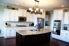 white kitchen cabinets with a dark wood island. LOVE!