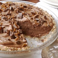 This pie has two outstanding characteristics.    Aunt Marg's French Silk Chocolate Pie  ~  A crumbly pecan-studded crust and Chopped Skor or Heath Bar on top!  YUMMY!