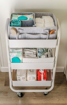 These nursery organization ideas for small spaces are amazing! Try these easy DIY storage hacks. You'll be organizing your baby supplies like a pro. You have to see this three tier utility cart, it's perfect for storing diapers, wipes, and all the baby essentials. #joyfullygrowingblog #organization #baby #nursery