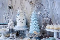 Winter Woodland wedding reception dessert table.. so pretty! Love the pastel blue, cream and white colors together.
