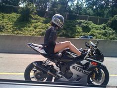 Girl riding with no...