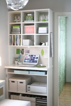 Small Home Office Design Ideas. A bookcase outfitted with clever storage containers and inserts, makes a compact office. The ottoman seen in front of the unit can be pulled up when working and also provies extra storage for supplies.