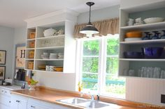 I love the open cabinets, it makes the space feel so big!!