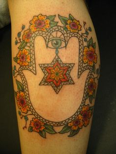 Ok. This Hamsa/Star of David tattoo is an oxymoron because Jews are not allowed to have tattoos. But setting that aside, what a beautiful tattoo! hand, artists, faith, star of david, flowers, tattoo, design, hamsa, calves