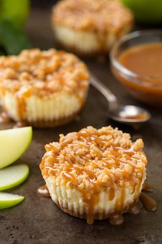 Caramel Apple Mini Cheesecakes with Streusel Topping - they are 5 layers of pure heaven!! The salted caramel sauce is the only way to go.