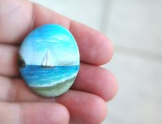 painted stones . I have some like this from our summers at the Cape. We would all sit around in the evenings and paint beach stones gathered at Nauset beach.